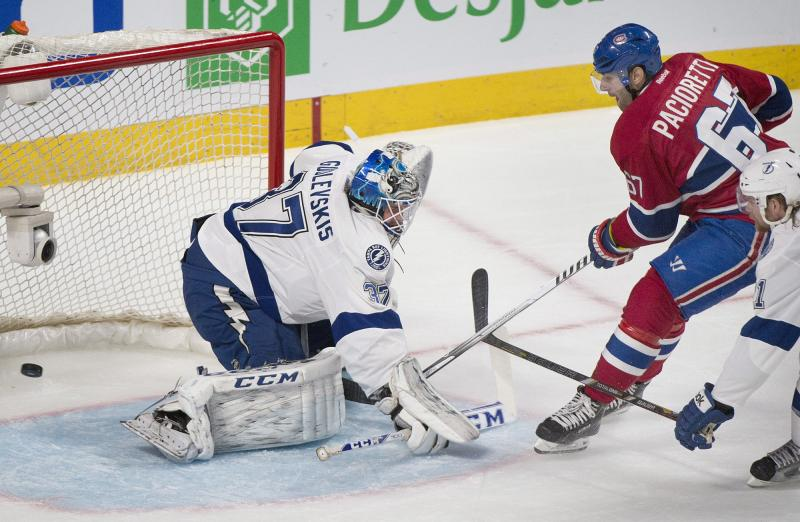 Montreal Canadiens' Max Pacioretty slides in on Tampa Bay Lightning's goaltender Kristers Gudlevskis during second period NHL Stanley Cup playoff action in Montreal, Tuesday, April 22, 2014