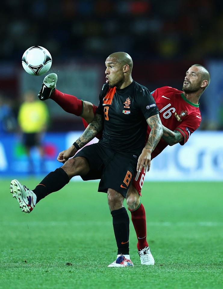 KHARKOV, UKRAINE - JUNE 17:  Raul Meireles (R) of Portugal battles for the ball with Nigel de Jong of Netherlands during the UEFA EURO 2012 group B match between Portugal and Netherlands at Metalist Stadium on June 17, 2012 in Kharkov, Ukraine.  (Photo by Ian Walton/Getty Images)