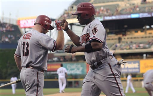 Hill drives in 4 as Diamondbacks beat Rockies 8-7