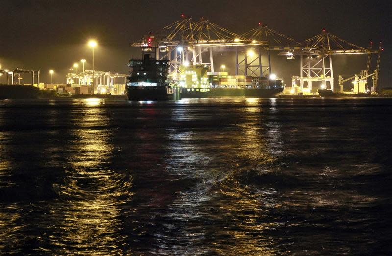 A container ship is docked at a port in Vallarpadam in Kochi