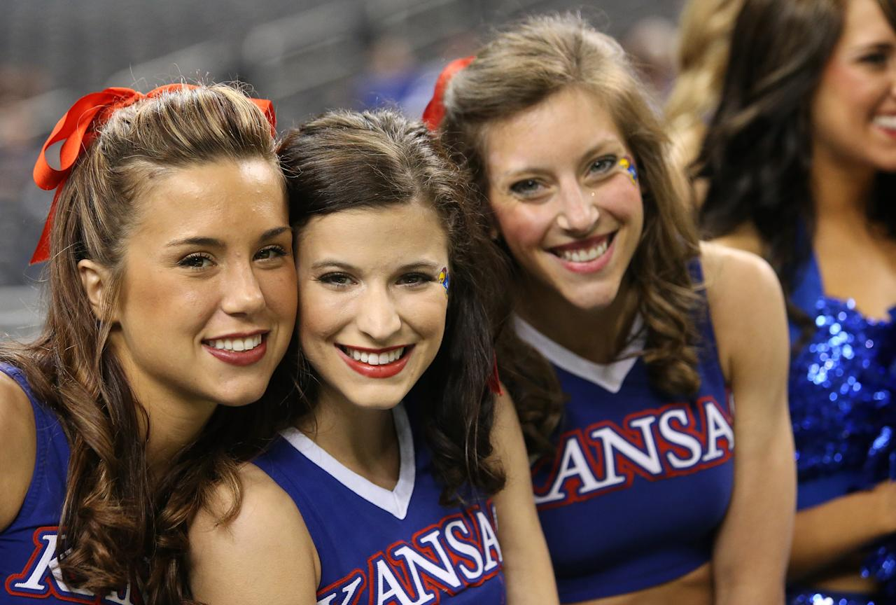 NEW ORLEANS, LA - MARCH 30:  Kansas Jayhawks cheerleaders pose during practice prior to the 2012 Final Four of the NCAA Division I Men's Basketball Tournament at the Mercedes-Benz Superdome on March 30, 2012 in New Orleans, Louisiana.  (Photo by Ronald Martinez/Getty Images)