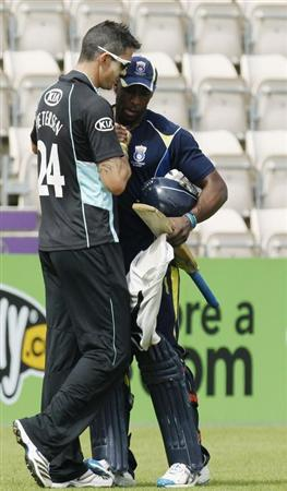 Kevin Pietersen (L) greets Hampshire Royals' Michael Carberry at the Hampshire Ageas Bowl ahead of the match between Hampshire Royals and Surrey Lions in Southampton, southern England August 19, 2012.