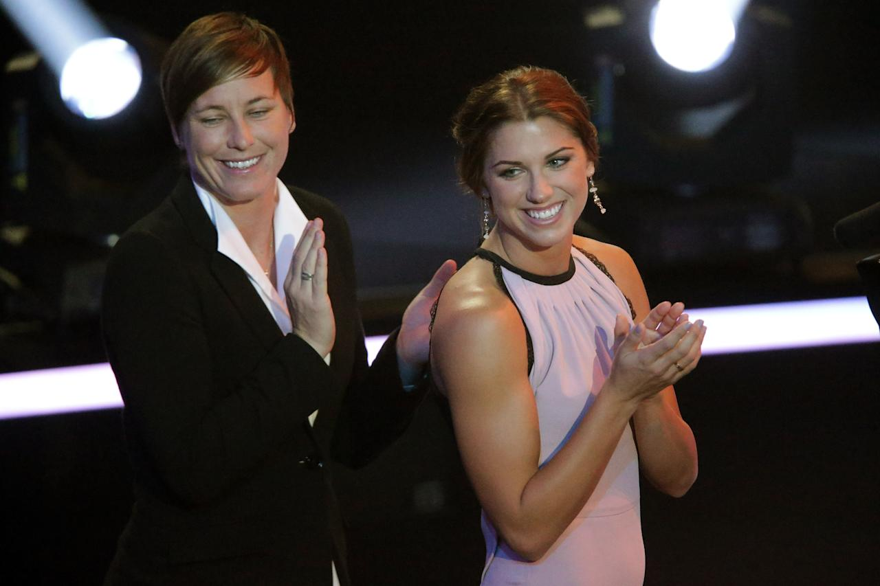 ZURICH, SWITZERLAND - JANUARY 07: (L-R) Abby Wambach of the United States and Alex Morgan of the United States applaud Pia Sudhage, women's coach of United States receiving the FIFA World Coach of Women's Football 2012 trophy at Congress House on January 7, 2013 in Zurich, Switzerland. (Photo by Christof Koepsel/Getty Images)