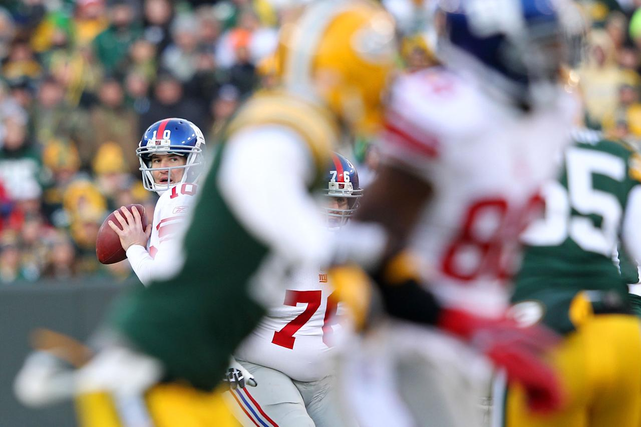 GREEN BAY, WI - JANUARY 15:  Eli Manning #10 of the New York Giants drops back to pass against the Green Bay Packers during their NFC Divisional playoff game at Lambeau Field on January 15, 2012 in Green Bay, Wisconsin.  (Photo by Jamie Squire/Getty Images)