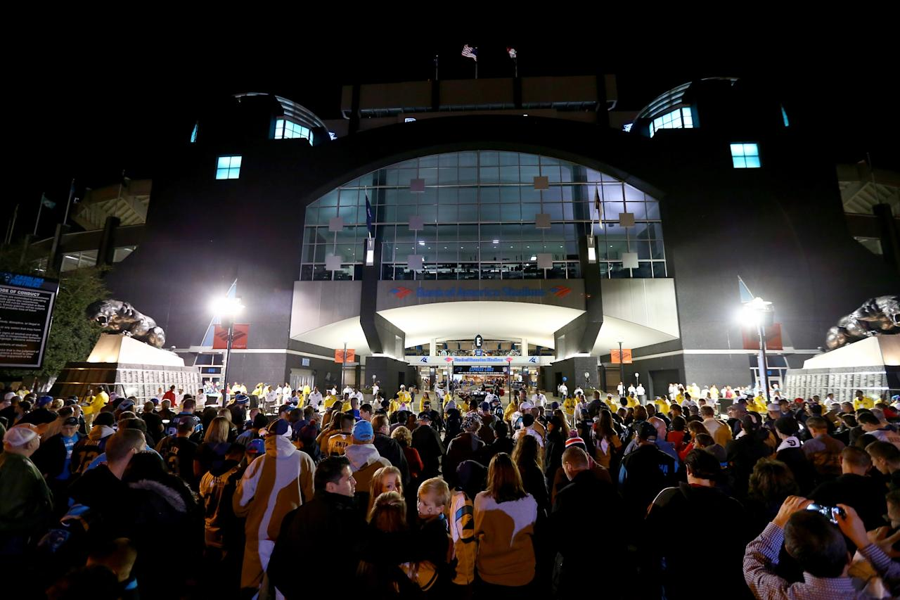CHARLOTTE, NC - NOVEMBER 18: Fans line up outside of Bank of America Stadium ahead of the Monday Night Football game between the New England Patriots and Carolina Panthers on November 18, 2013 in Charlotte, North Carolina. (Photo by Streeter Lecka/Getty Images)