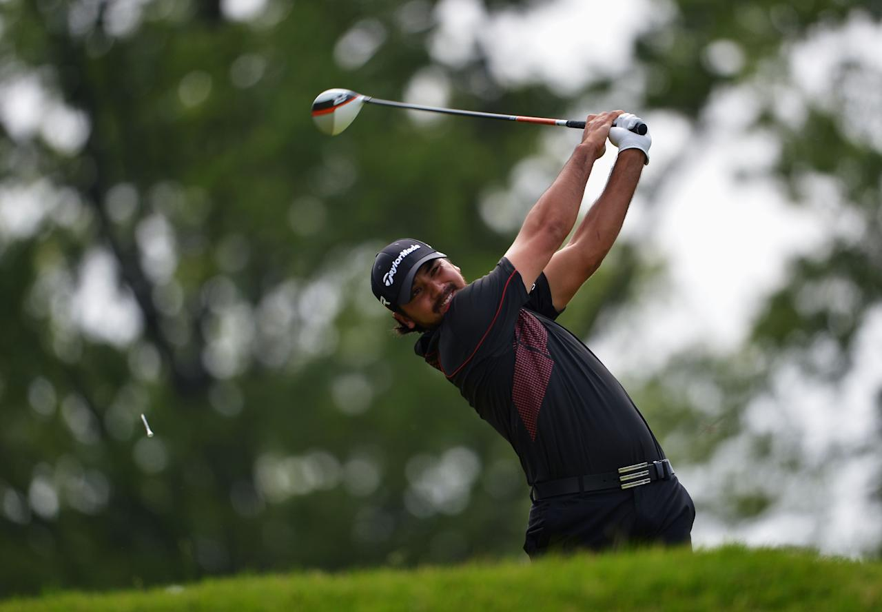 ARDMORE, PA - JUNE 16: Jason Day of Australia hits his tee shot on the fourth hole during the final round of the 113th U.S. Open at Merion Golf Club on June 16, 2013 in Ardmore, Pennsylvania. (Photo by Drew Hallowell/Getty Images)