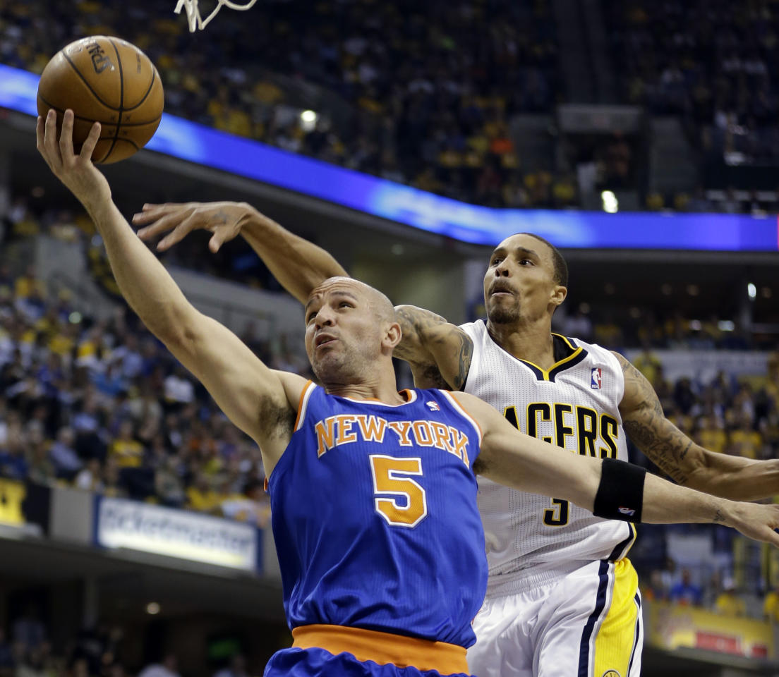New York Knicks' Jason Kidd (5) shoots past Indiana Pacers' George Hill during the first half of Game 4 of an Eastern Conference semifinal NBA basketball playoff series on Tuesday, May 14, 2013, in Indianapolis. (AP Photo/Darron Cummings)