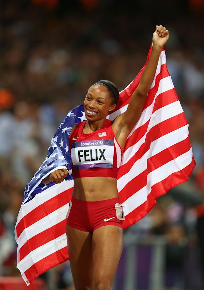 LONDON, ENGLAND - AUGUST 08:  Allyson Felix of the United States celebrates after winning gold in the Women's 200m Final on Day 12 of the London 2012 Olympic Games at Olympic Stadium on August 8, 2012 in London, England.  (Photo by Michael Steele/Getty Images)