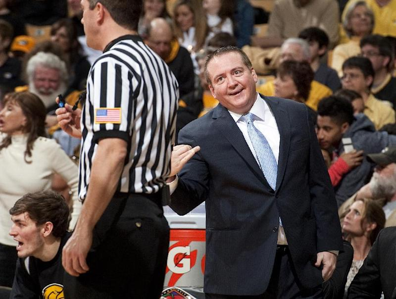 Southern Mississippi head coach Donnie Tyndall discusses a call with the referee during the first half of an NCAA college basketball game against Missouri in the second round of the NIT tournament Sunday, March 23, 2014, in Columbia, Mo. Southern Mississippi won 71-63