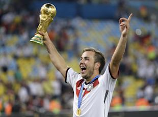 Germany's Mario Goetze celebrates with the World Cup trophy. (AP)