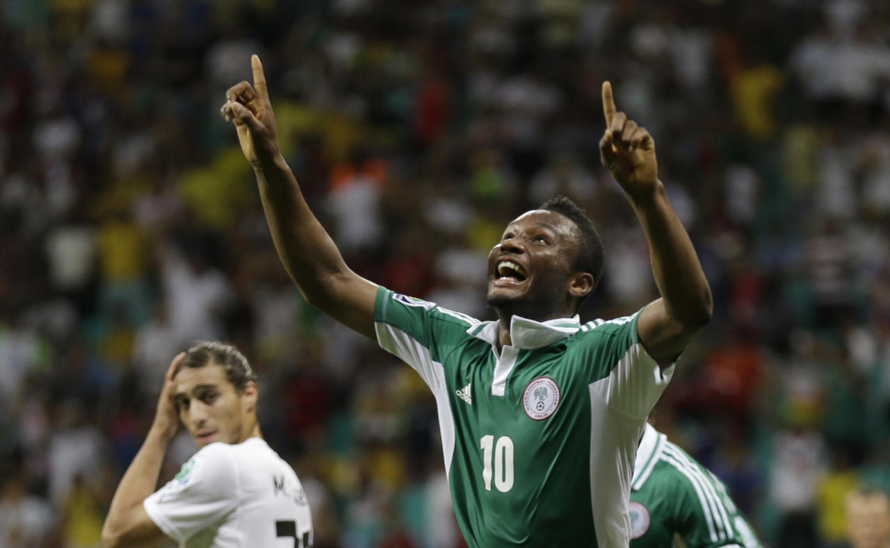 FILE - In this June 20, 2013, file photo, Nigeria's John Obi Mikel celebrates scoring his side's first goal during the soccer Confederations Cup group B match between Nigeria and Uruguay at Fonte Nova stadium in Salvador, Brazil. (AP Photo/Natacha Pisarenko, File) - SEE FURTHER WORLD CUP CONTENT AT APIMAGES.COM
