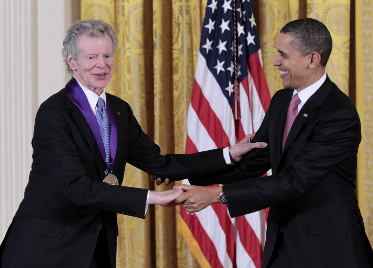 President Barack Obama presents a 2010 National Medal of Arts to pianist Van Cliburn, Wednesday, March 2, 2011, during a ceremony in the East Room of the White House in Washington.