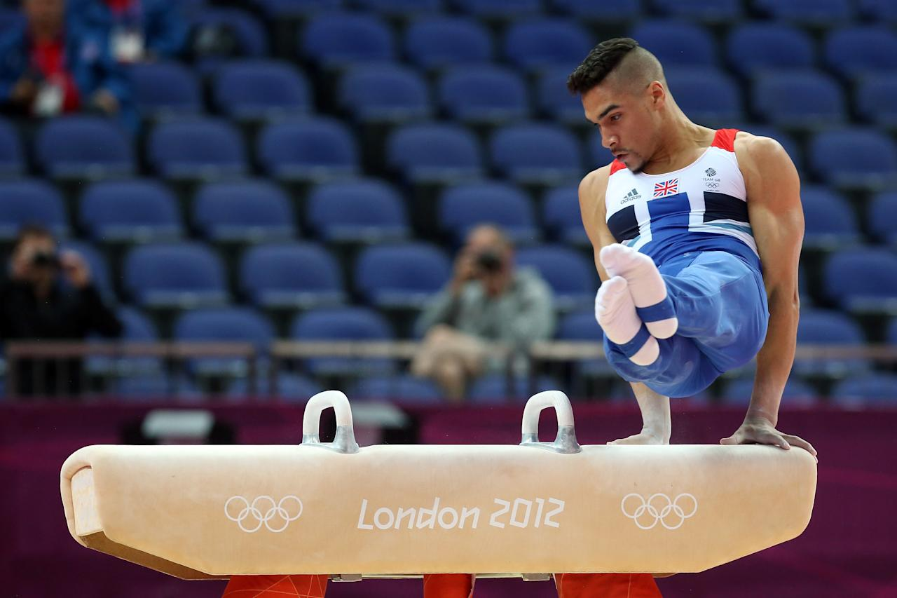 LONDON, ENGLAND - JULY 28:  Louis Smith of Great Britain competes in the pommel horse for the qualification of the Artistic Gymnastics Men's Team on day one of the London 2012 Olympic Games at North Greenwich Arena on July 28, 2012 in London, England.  (Photo by Ronald Martinez/Getty Images)