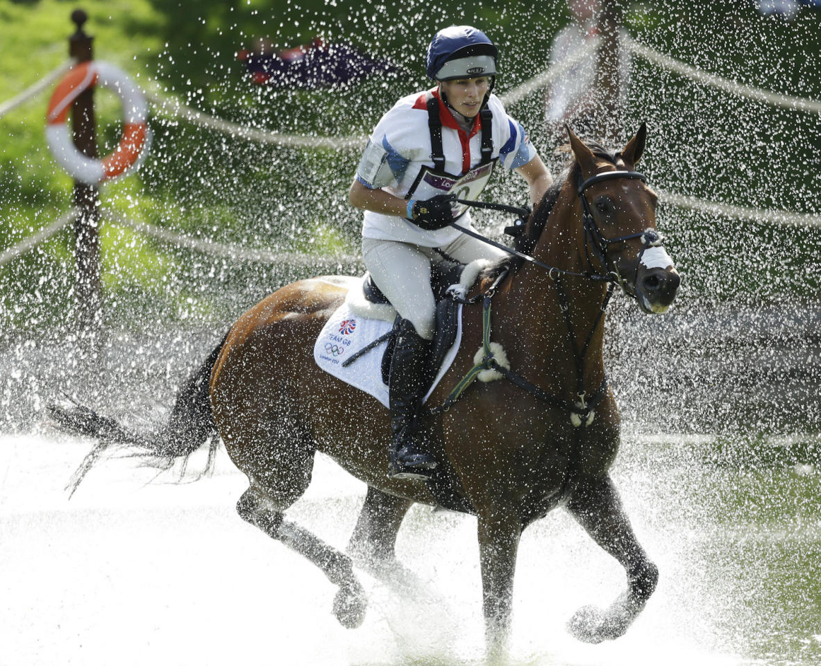 Zara Phillips of Great Britain rides High Kingdom as she competes in the equestrian eventing cross country phase at Greenwich Park, at the 2012 Summer Olympics, Monday, July 30, 2012, in London. (AP Photo/Markus Schreiber)