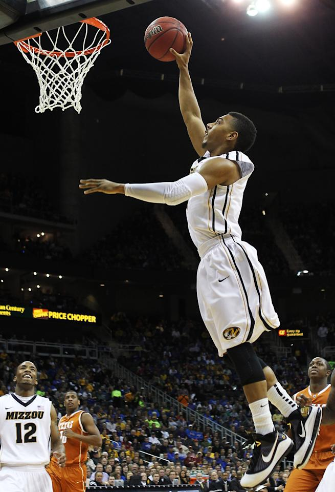 KANSAS CITY, MO - MARCH 09:  Phil Pressey #1 of the Missouri Tigers dunks against the Texas Longhorns in the first half during the semifinals of the 2012 Big 12 Men's Basketball Tournament at Sprint Center on March 9, 2012 in Kansas City, Missouri.  (Photo by Jamie Squire/Getty Images)