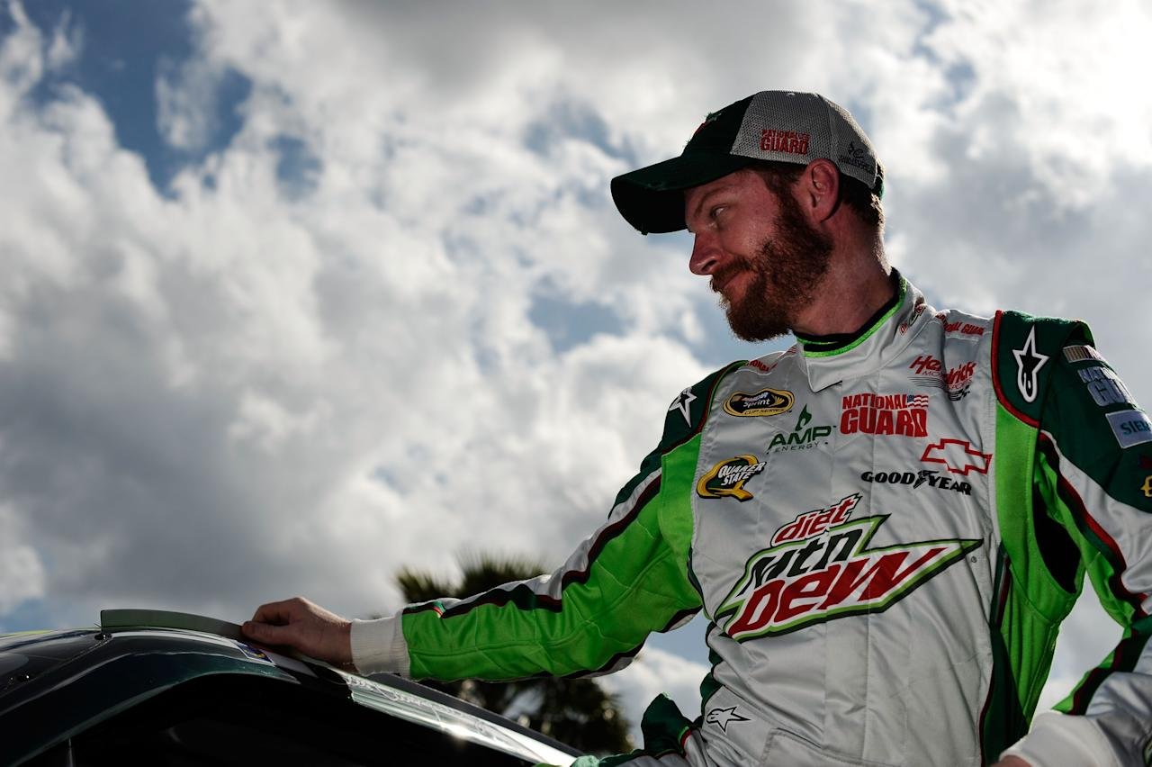 DAYTONA BEACH, FL - FEBRUARY 19:  Dale Earnhardt Jr., driver of the #88 Diet Mountain Dew/National Guard Chevrolet, gets out of his car during qualifying for the NASCAR Sprint Cup Series Daytona 500 at Daytona International Speedway on February 19, 2012 in Daytona Beach, Florida.  (Photo by Jared C. Tilton/Getty Images for NASCAR)
