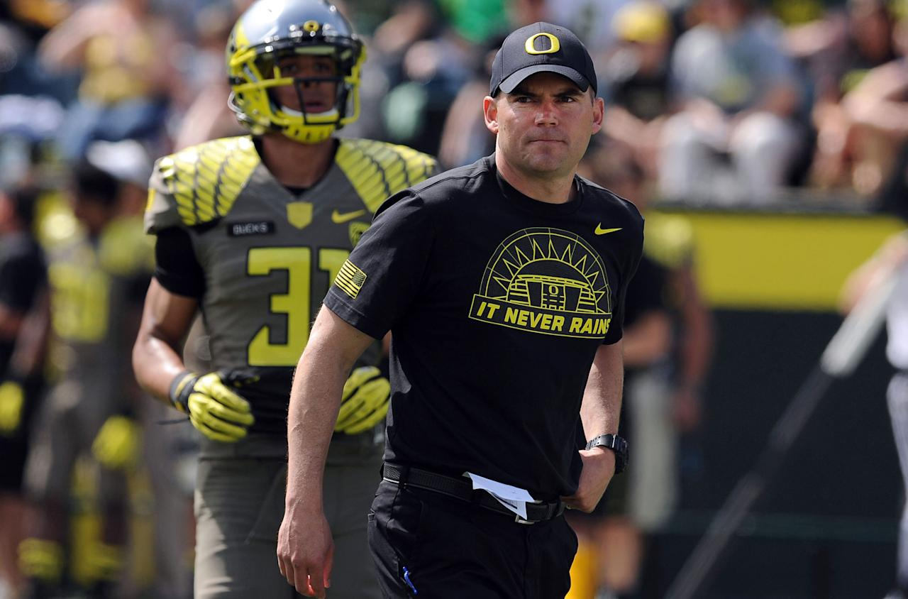 EUGENE, OR - APRIL 27: Head coach Mark Helfrich of the Oregon Ducks watches the action on the field in the first half of the Oregon Spring Game at Autzen Stadium on April 27, 2013 in Eugene, Oregon. (Photo by Steve Dykes/Getty Images)