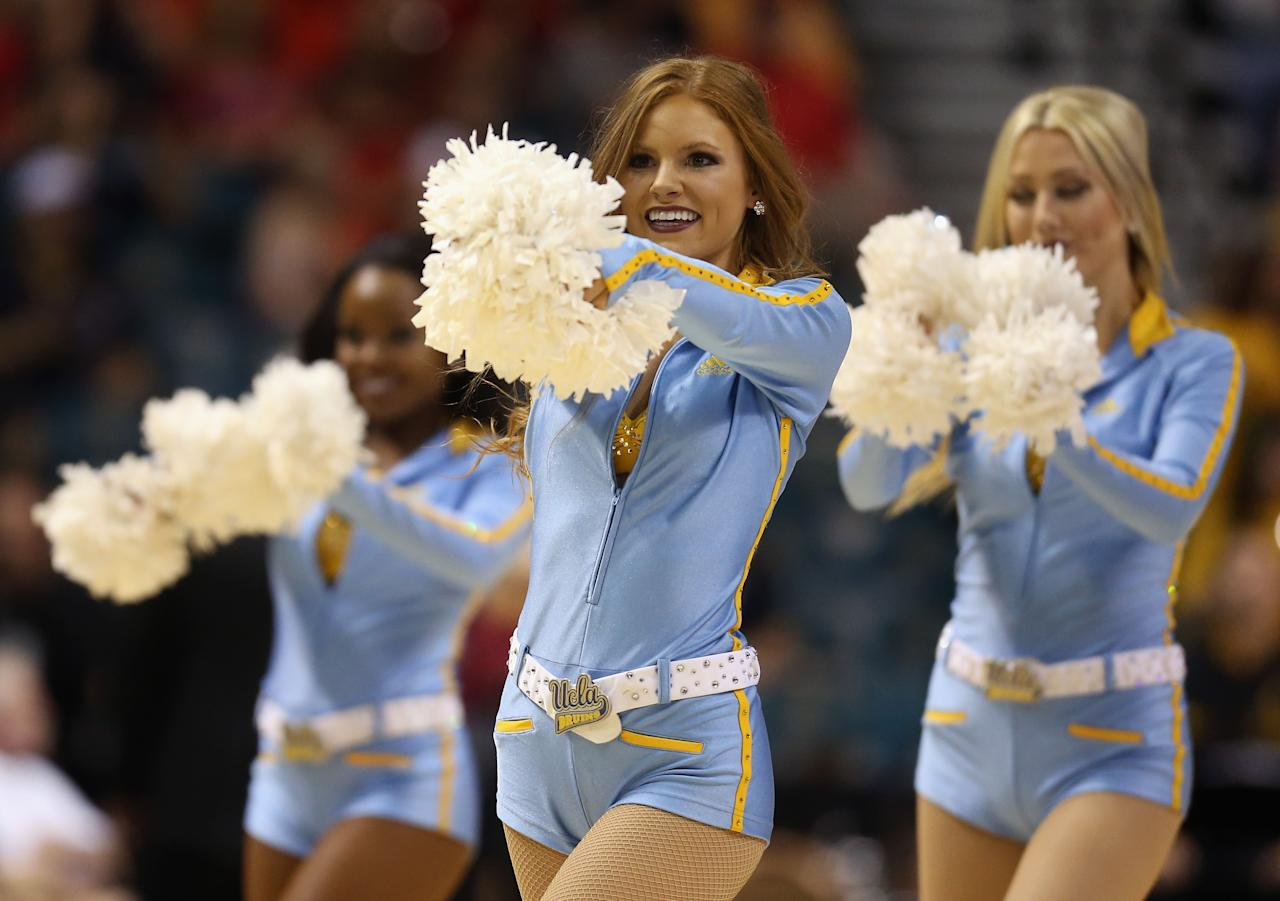 LAS VEGAS, NV - MARCH 14:  UCLA Bruins cheerleaders perform during the quarterfinals of the Pac 12 Basketball Tournament at the MGM Grand Garden Arena on March 14, 2013 in Las Vegas, Nevada.  (Photo by Jeff Gross/Getty Images)