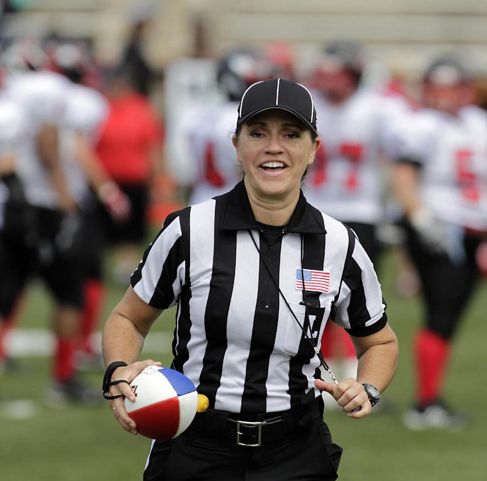 IMAGE DISTRIBUTED FOR NATIONAL FOOTBALL LEAGUE - Line Judge Catherine Conti retrieves the football at the Legacy Bowl Women's Football Championship, on Friday July 25, 2014 at District Three Stadium in Rock Hill, S.C. The Carolina Queens beat the Minnesota Vixens 28-22. (Bob Leverone/AP Images for National Football League)