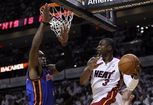 Miami Heat's Dwyane Wade (3) looks to pass as New York Knicks' Amare Stoudemire, left, defends in the first half during an NBA basketball game in the first round of the Eastern Conference playoffs in Miami, Saturday, April 28, 2012. (AP Photo/Lynne Sladky)