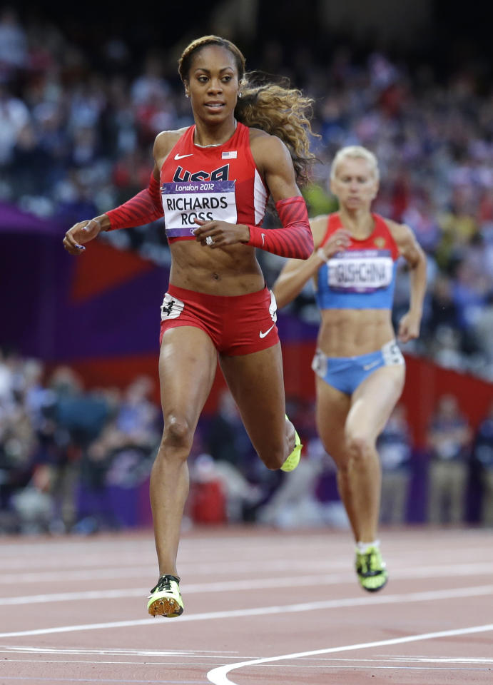United States' Sanya Richards-Ross crosses the finish line in a women's 400-meter semifinal  during the athletics in the Olympic Stadium at the 2012 Summer Olympics, London, Saturday, Aug. 4, 2012. (AP Photo/Anja Niedringhaus)