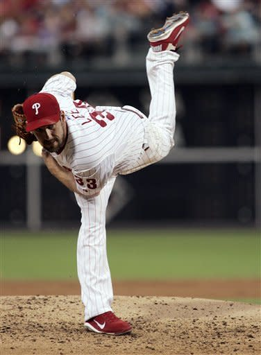 Philadelphia Phillies' Cliff Lee follows through on a pitch in the first inning of a baseball game with the St. Louis Cardinals, Saturday, Aug. 11, 2012, in Philadelphia. (AP Photo/Tom Mihalek)
