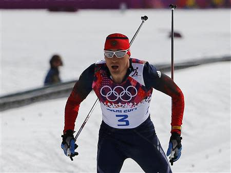 Russia's Legkov approaches the finish line to win the men's cross-country 50 km mass start free event at the Sochi 2014 Winter Olympic Games in Rosa Khutor