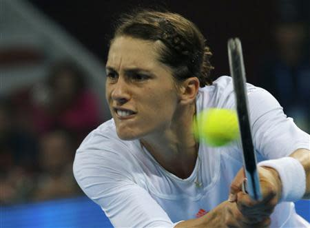 Petkovic of Germany hits return against Azarenka of Belarus at the China Open tennis tournament in Beijing