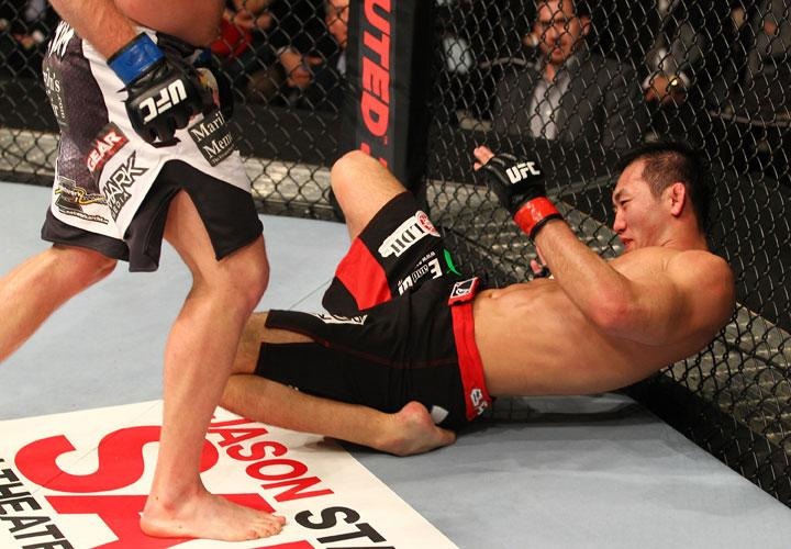 SAITAMA, JAPAN - FEBRUARY 26: Yushin Okami lies on the canvas after being knocked down by a punch from Tim Boetsch during the UFC 144 event at Saitama Super Arena on February 26, 2012 in Saitama, Japan.