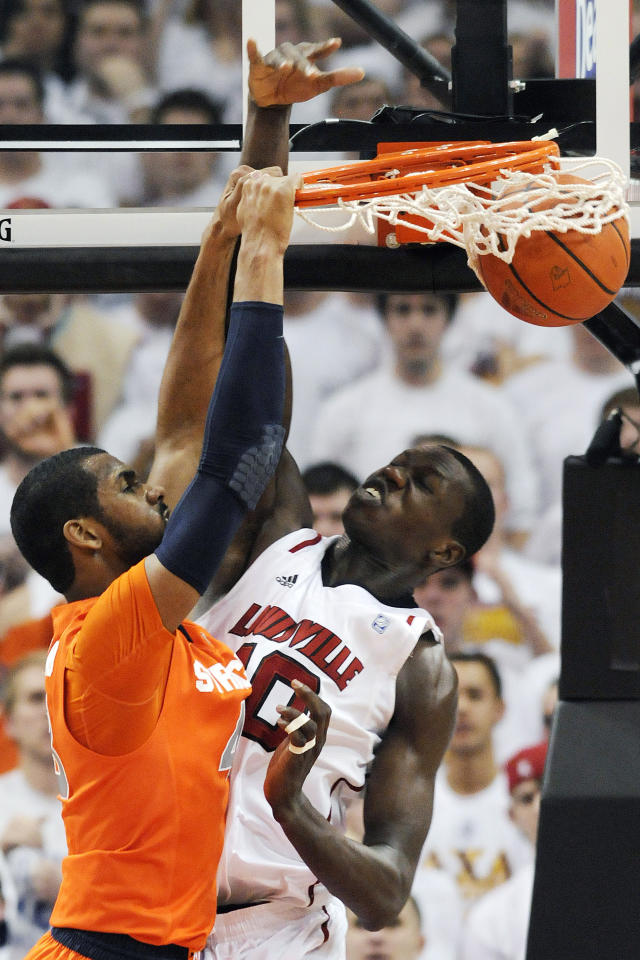 Syracuse's James Southerland, left, dunks on Louisville's Gorgui Dieng during the second half of their NCAA college basketball game, Monday, Feb. 13, 2012, in Louisville, Ky. Syracuse won 52-51. (AP Photo/Timothy D. Easley)