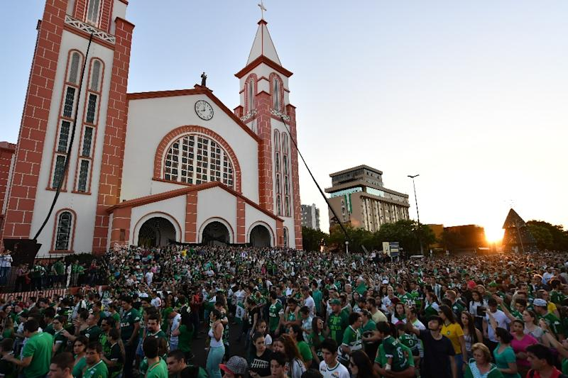 People surround a church during a mass in memoriam of the players of Brazilian team Chapecoense Real killed in a plane crash in the Colombian mountains in Chapeco in the southern Brazilian state of Santa Catarina