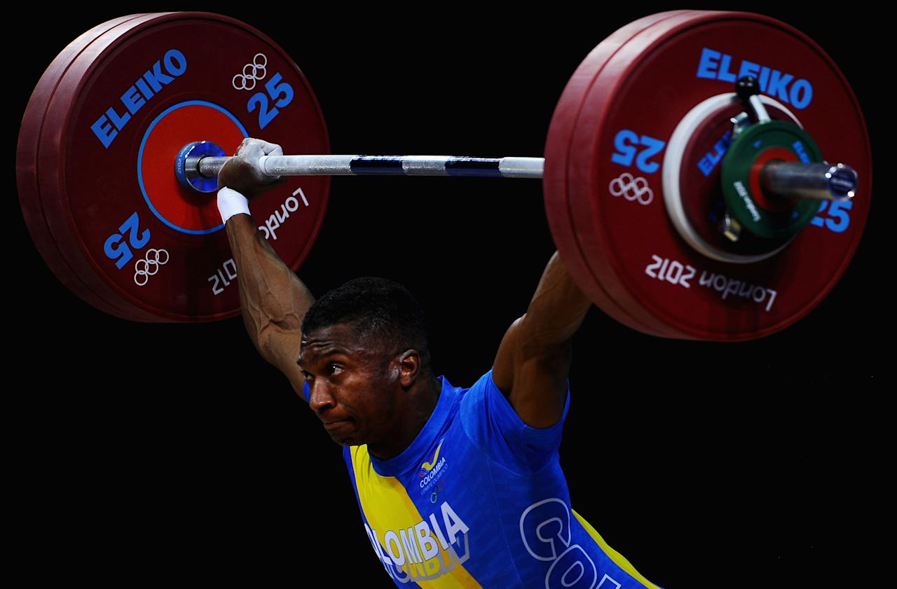 LONDON, ENGLAND - JULY 30:  Oscar Albeiro Figueroa Mosquera of Colombia competes during the Men's 62kg Weightlifting on Day 3 of the London 2012 Olympic Games at ExCeL on July 30, 2012 in London, England.  (Photo by Laurence Griffiths/Getty Images)