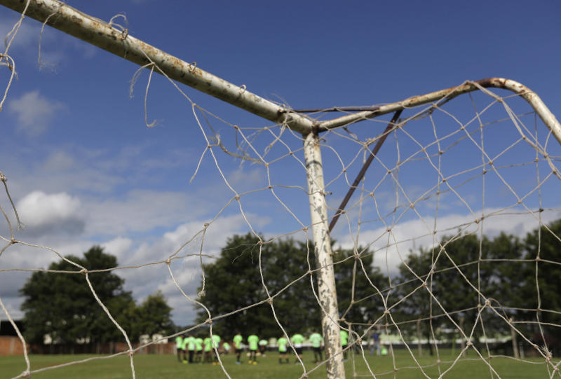 Reality of 'beautiful game' turns ugly in Brazil