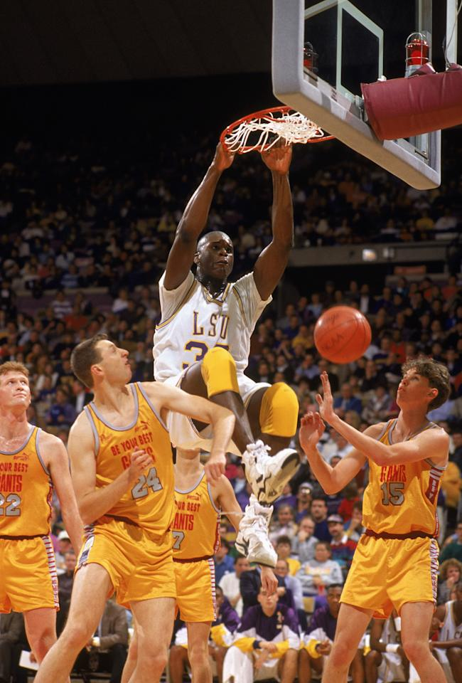 Shaquille O'Neal of LSU dunks against helpless defenders from the University of Tennessee Volunteers in a 1991 NCAA game. (Getty Images)