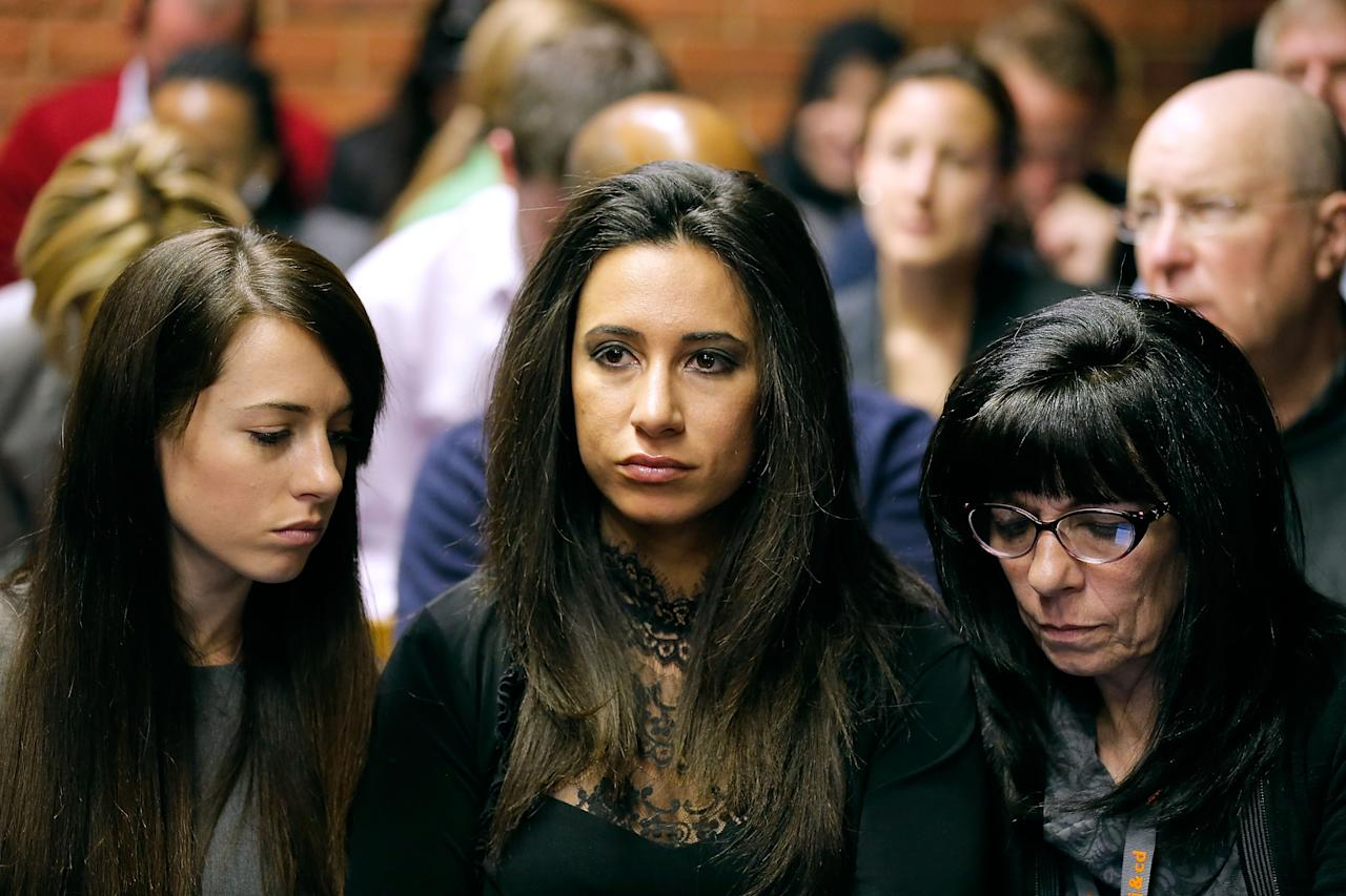 PRETORIA, SOUTH AFRICA - AUGUST 19: Gina Myers (C), a close personal friend to model Reeva Steenkamp is seen at the indictment hearing for South African athelete Oscar Pistorius at Pretoria Magistrates Court on August 19, 2013. Pistorius, 26, is accused of murdering his girlfriend Reeva Steenkamp which Pistorius denies claiming he mistook Steenkamp for an intruder. The indictment was served and the trial date of March 3, 2014 has now been set. (Photo by Jemal Countess/Getty Images)