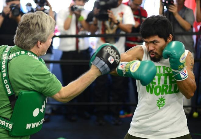 Freddie Roach (L) and Manny Pacquiao (R) of the Philippines take a media workout at Wild Card Boxing Club on May 30, 2012 in Hollywood, California. The workout is in advance of Pacquiao's upcoming WBO welterweight championship fight against Timothy Bradley of US on June 9 at the MGM Grand in Las Vegas. AFP PHOTO/JOE KLAMARJOE KLAMAR/AFP/GettyImages