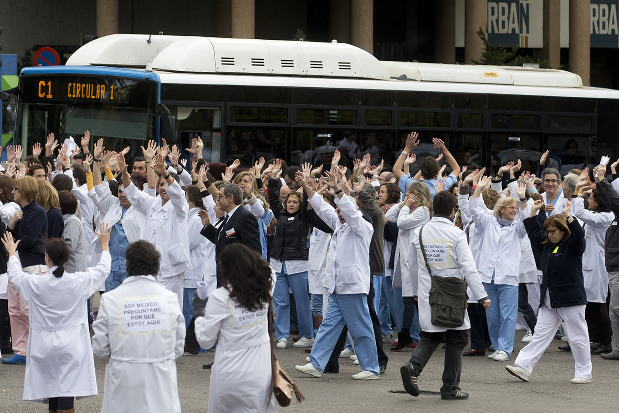 Staff from the Clinico San Carlos hospital block the traffic outside the hospital during a protest against cuts in the national health service in Madrid.