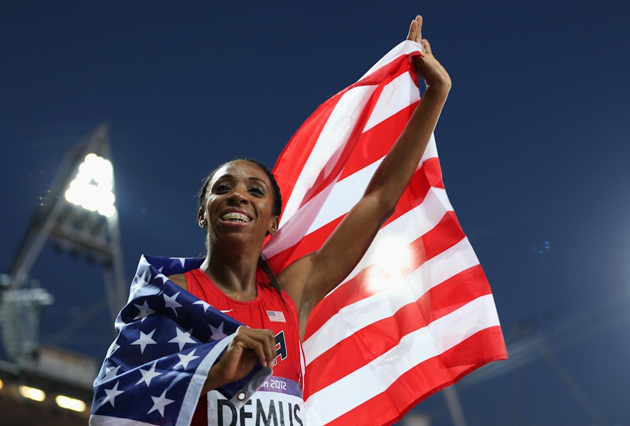 Silver medalist Lashinda Demus of the United States celebrates afte the Women's 400m Hurdles Final on Day 12 of the London 2012 Olympic Games at Olympic Stadium on August 8, 2012 in London, England.  (Photo by Clive Brunskill/Getty Images)