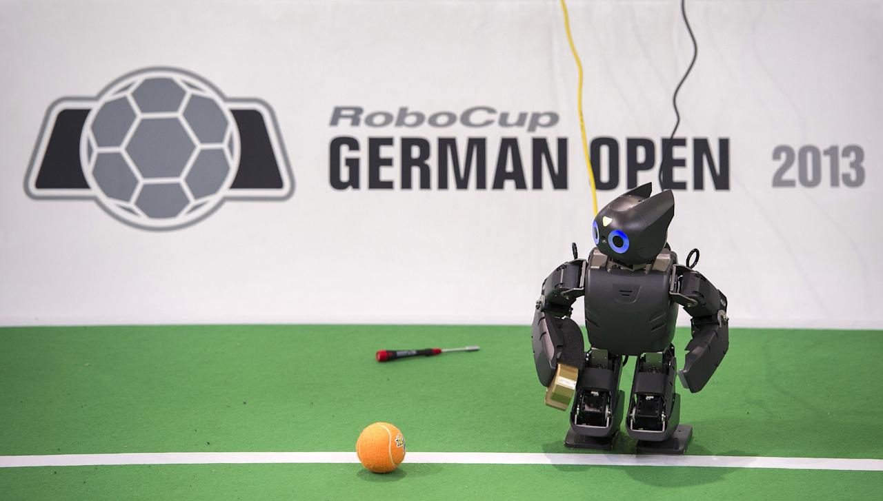 MAGDEBURG, GERMANY - APRIL 26:  A robot in the play field at the 2013 RoboCup German Open tournament on April 26, 2013 in Magdeburg, Germany. The robots, which are a model called Nao, manufactured by Aldebaran Robotics, perform autonomously and communicate with one another via WLAN. The three-day tournament is hosting 43 international teams and 158 German junior teams that compete in a variety of disciplines, including soccer, rescue and dance.  (Photo by Jens Schlueter/Getty Images)