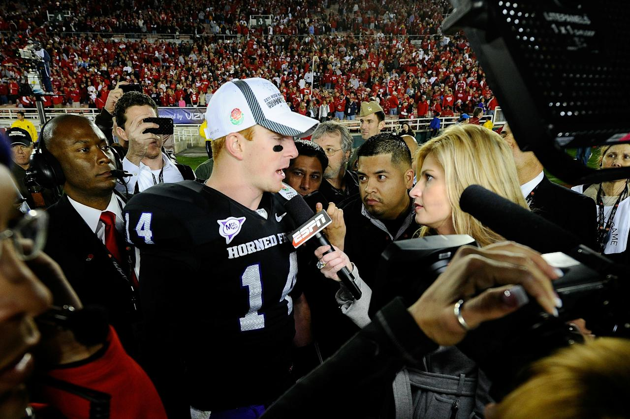 PASADENA, CA - JANUARY 01:  Quarterback Andy Dalton #14 of the TCU Horned Frogs is interviewed by reporter Erin Andrews after defeating the Wisconsin Badgers 21-19 in the 97th Rose Bowl game on January 1, 2011 in Pasadena, California.  (Photo by Kevork Djansezian/Getty Images)