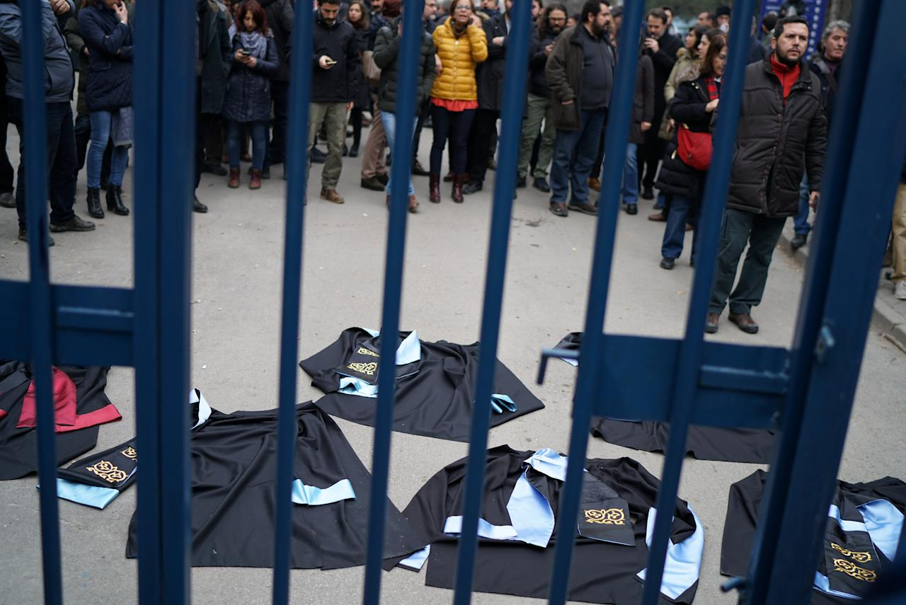 Academics lay down their gowns during a protest against the dismissal of academics from universities following a post-coup emergency decree, at the Cebeci campus of Ankara University in Ankara, Turkey, February 10, 2017. REUTERS/Umit Bektas