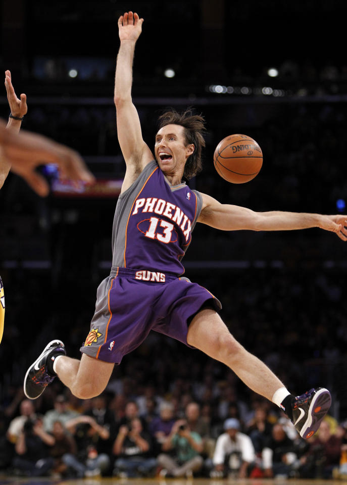 Phoenix Suns guard Nash is fouled on a three-point shot by Los Angeles Lakers guard Fisher. 2012. Danny Moloshok / Reuters
