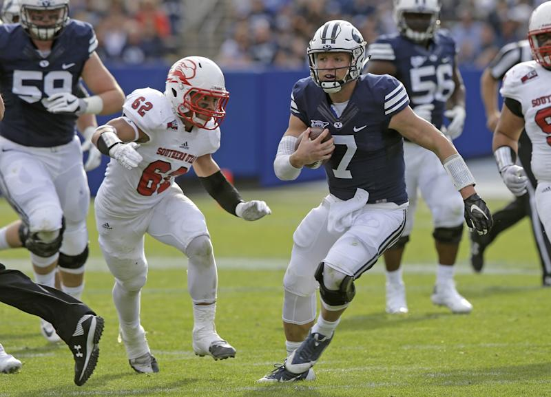 BYU QB Taysom Hill has thrown for 2,323 yards, rushed for 603 yards and combined for 20 TDs this season. (AP Photo/Rick Bowmer)