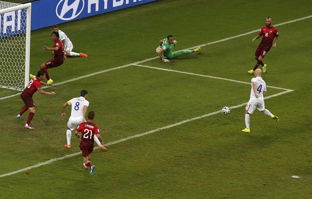 Michael Bradley (4) of the U.S. misses a goal opportunity during their 2014 World Cup Group G soccer match against Portugal at the Amazonia arena in Manaus June 22, 2014. REUTERS/Andres Stapff (BRAZIL - Tags: SOCCER SPORT WORLD CUP)
