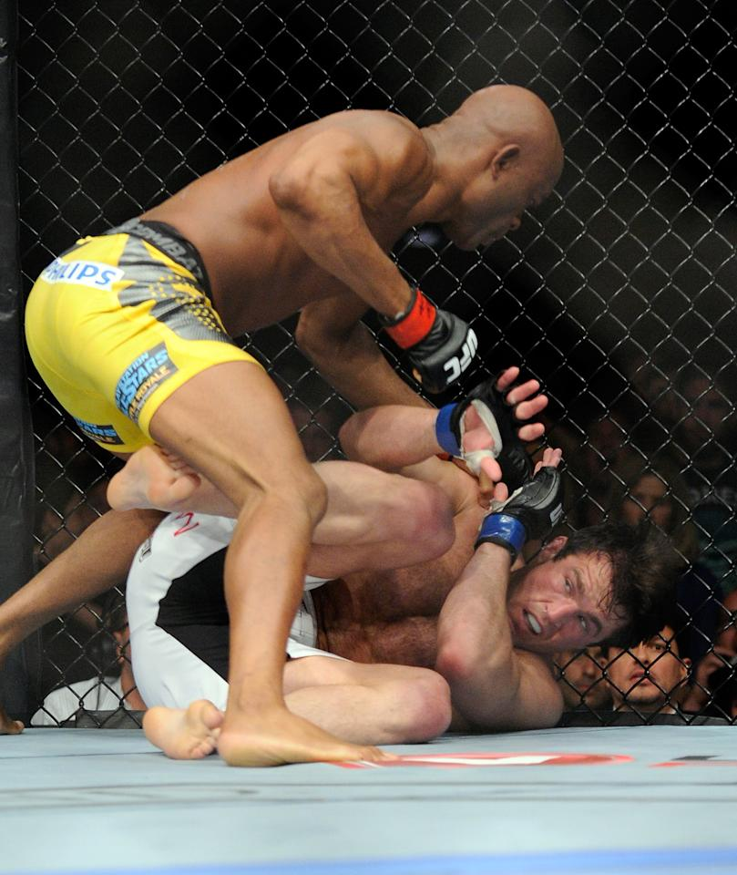 Anderson Silva punches Chael Sonnen during the second round of their UFC 148 middleweight championship fight at the MGM Grand Garden Arena Saturday, July 7, 2012 in Las Vegas. Silva won with a TKO. (AP Photo/David Becker)