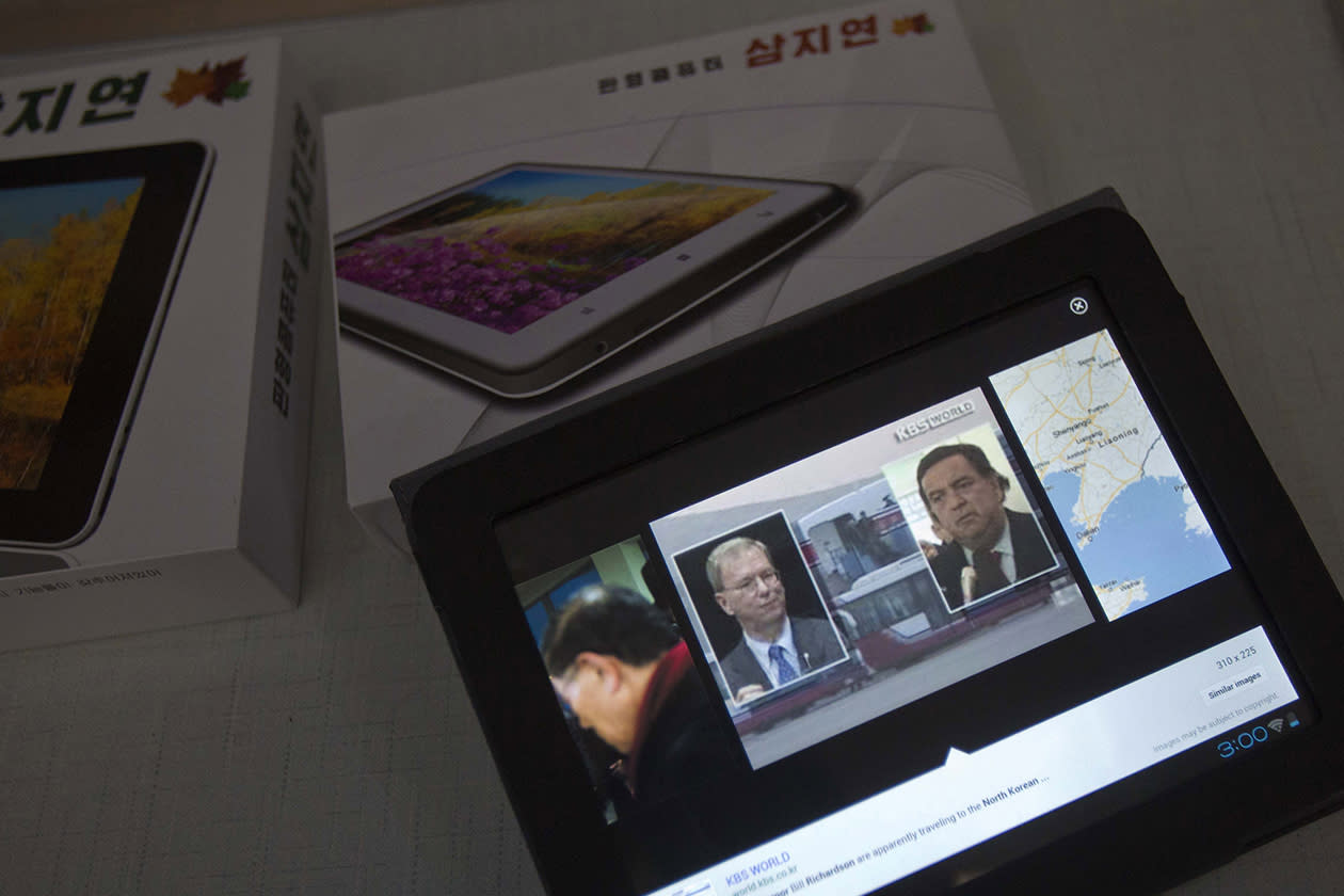 An image from a South Korean television website, showing photographs of Executive Chairman of Google, Eric Schmidt, and former Governor of New Mexico Bill Richardson, appear on the screen of a tablet computer running North Korean-developed software at the Korean Computer Center in Pyongyang, North Korea.