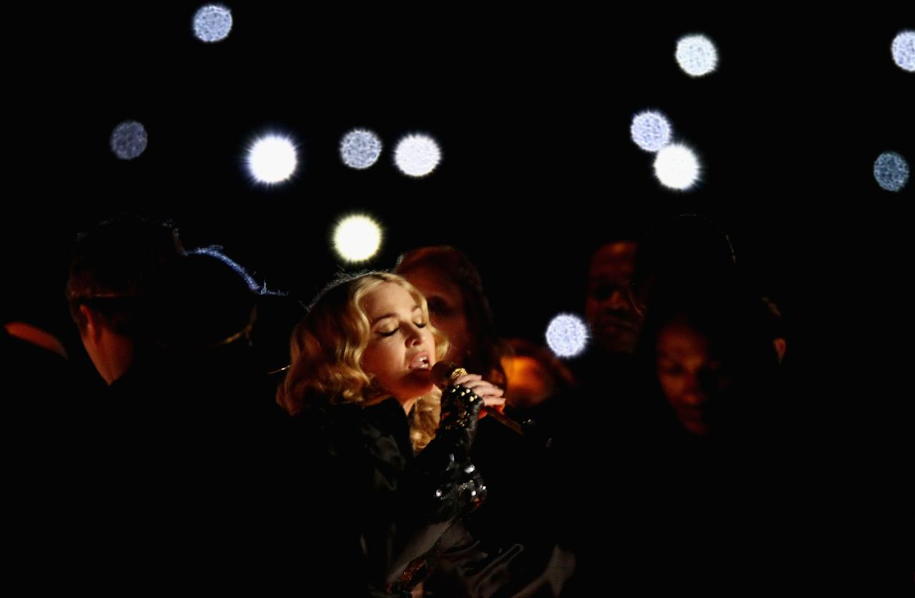 INDIANAPOLIS, IN - FEBRUARY 05:  Singer Madonna performs during the Bridgestone Super Bowl XLVI Halftime Show at Lucas Oil Stadium on February 5, 2012 in Indianapolis, Indiana.  (Photo by Win McNamee/Getty Images)