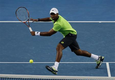 Donald Young of the United States plays a return to Kei Nishikori of Japan during their men's singles match at the Australian Open 2014 tennis tournament in Melbourne