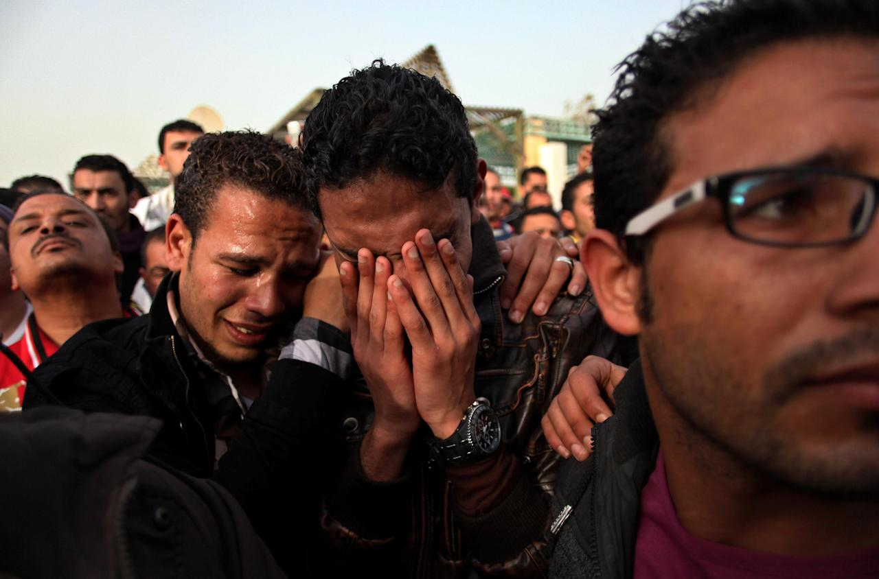Egyptians mourn during the funeral for Abd Alhaleem Mohanna, 23, who was killed on March 5, 2013 during clashes with riot police, in Port Said, Egypt, Friday, March 8, 2013. Egypt's police forces have withdrawn from the streets of this restive city on the Suez Canal, handing over security to the military after nearly a week of deadly clashes. (AP Photo/Khalil Hamra)