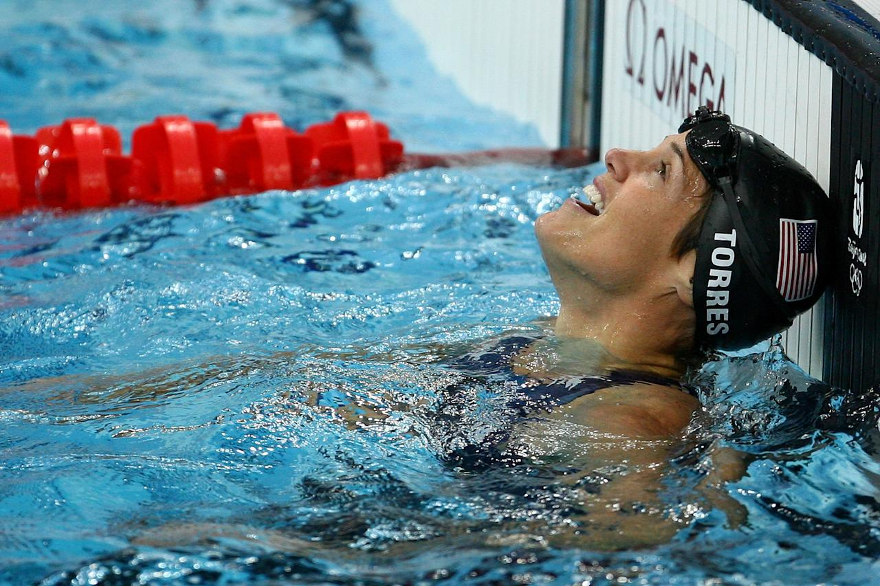 BEIJING - AUGUST 17:  Dara Torres of the United States reacts after winning the silver medal in the Women's 50m Freestyle final held at the National Aquatics Centre during Day 9 of the Beijing 2008 Olympic Games on August 17, 2008 in Beijing, China.  (Photo by Adam Pretty/Getty Images)